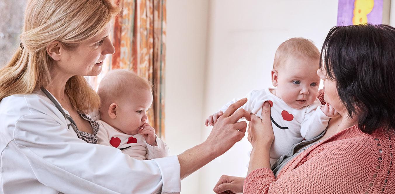 parents holding babies image